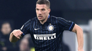Arsenal striker Podolski feels settled at Inter Milan but considering options