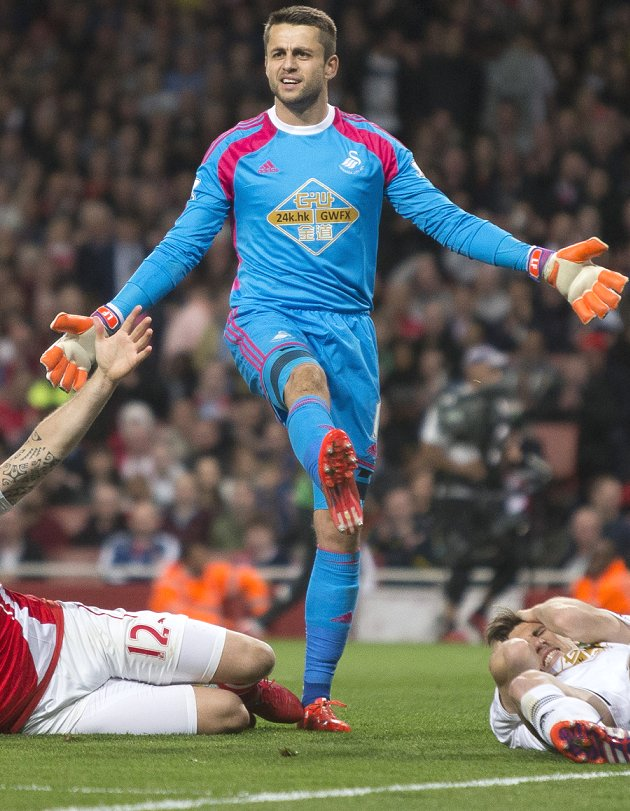 Swansea goalkeeper Fabianski defends underfire Renato Sanches