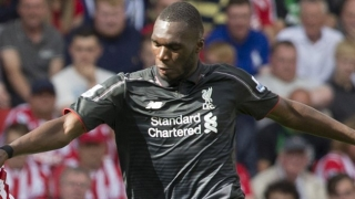 Benteke doing his best to remind people of his qualities - Liverpool and Belgium colleague Mignolet