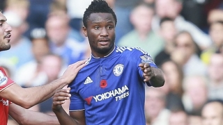 DONE DEAL: Chelsea veteran Mikel shakes hands with Tianjin TEDA