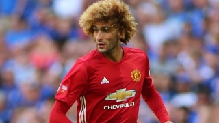 SUPER FELLI: Man Utd midfielder Fellaini helps woman in celebration crush