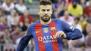 Barcelona defender Gerard Pique reacts to Shakira chants from Espanyol fans...