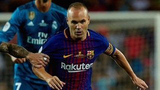 Barcelona captain Iniesta happy with new Pique deal