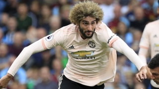 SNAPPED! Man Utd midfielder Fellaini takes new hair cut